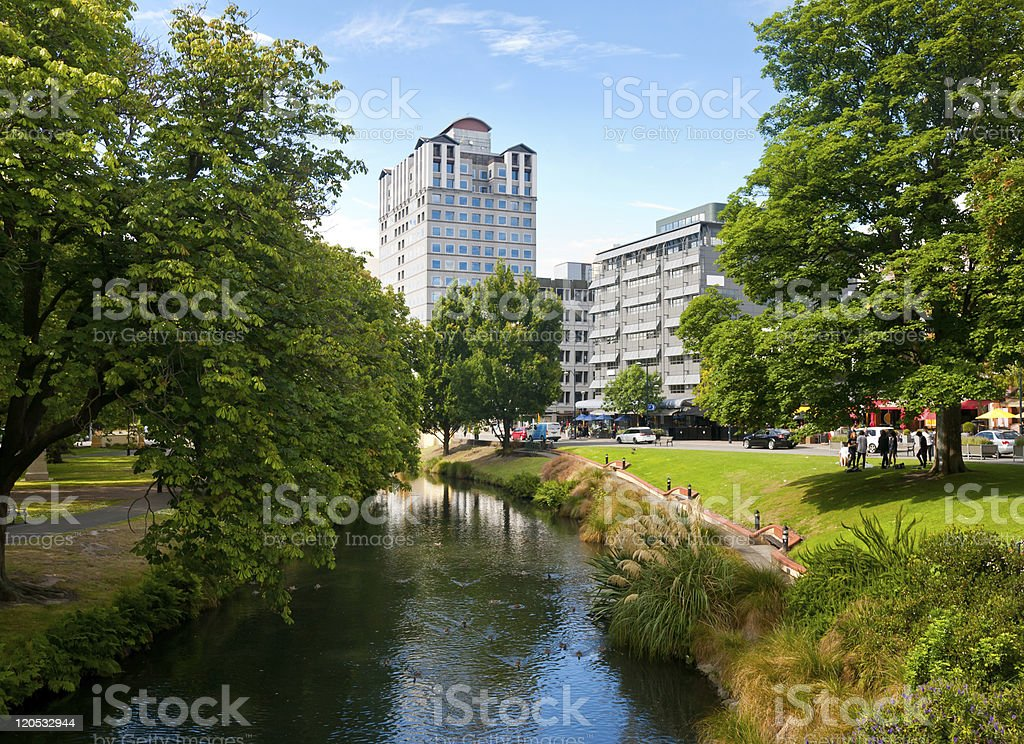 Christchurch cityscape with creek and green trees stock photo