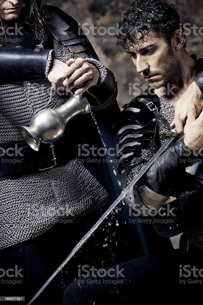christening of medieval sword stock photo