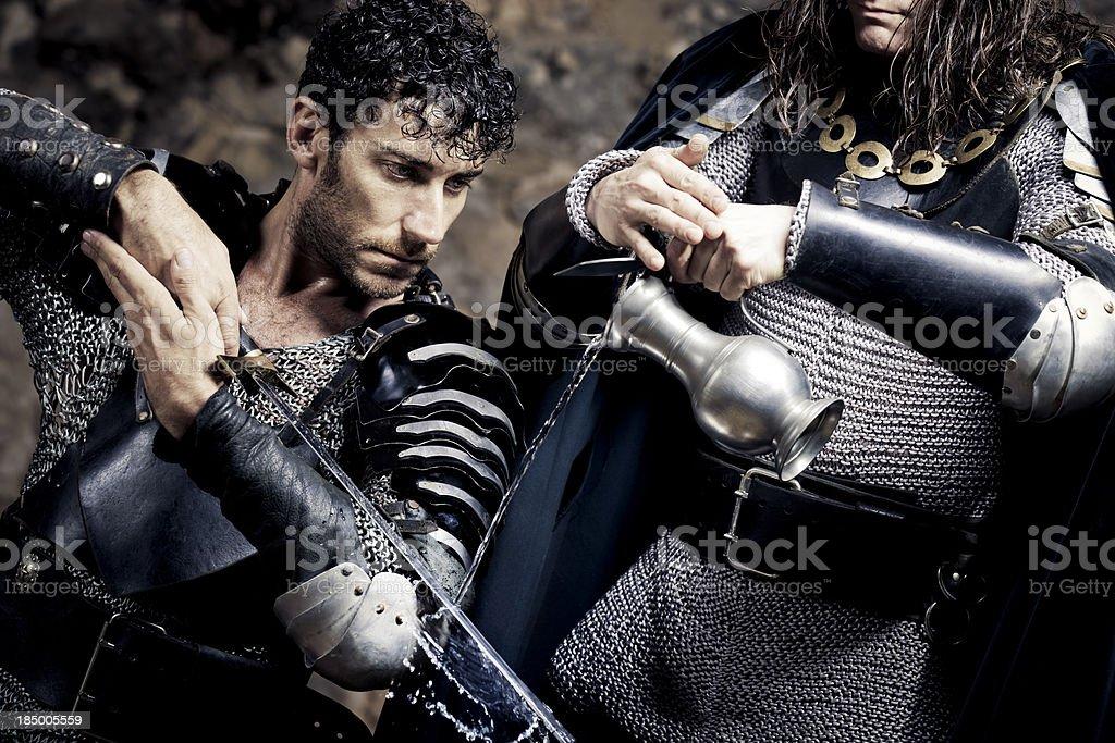 christening rite of medieval sword stock photo