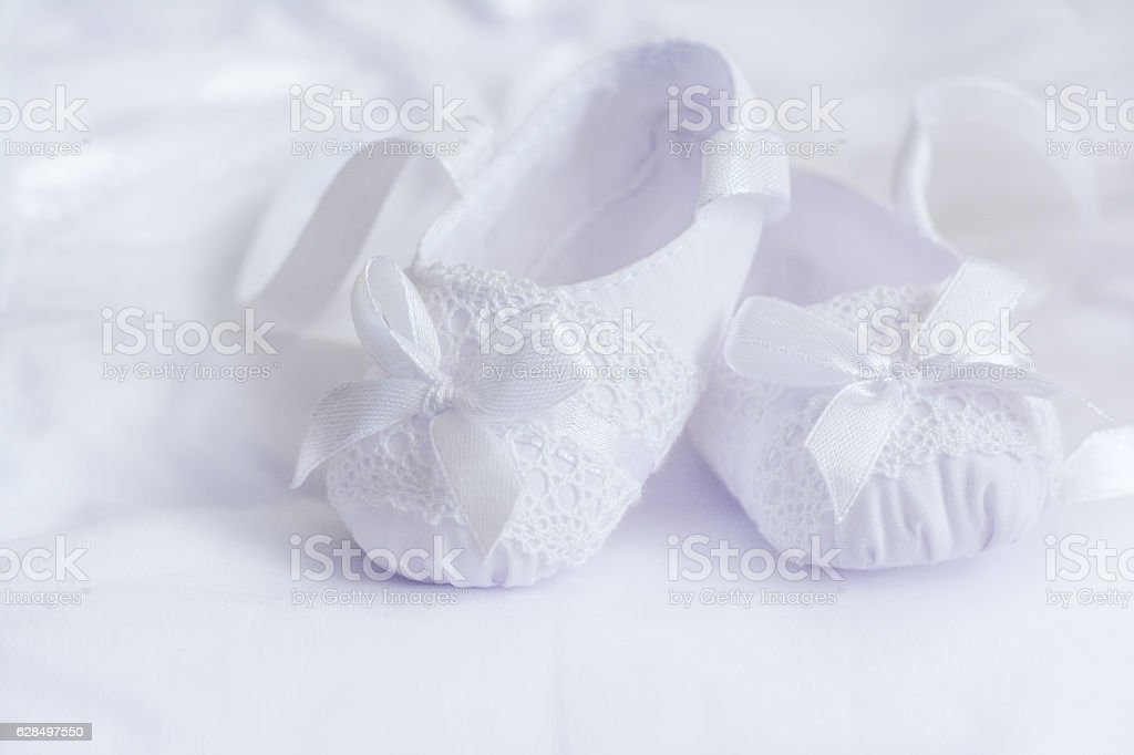 Christening textile booties for little baby stock photo
