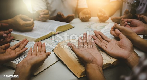 Christian Bible Study Concepts Christian followers are studying the word of God in churches.