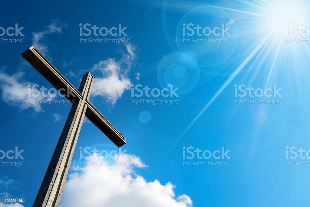 Christian Cross Against a Blue Sky stock photo