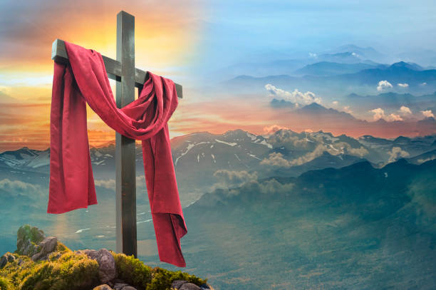 Christian cross against the sky over the mountains stock photo