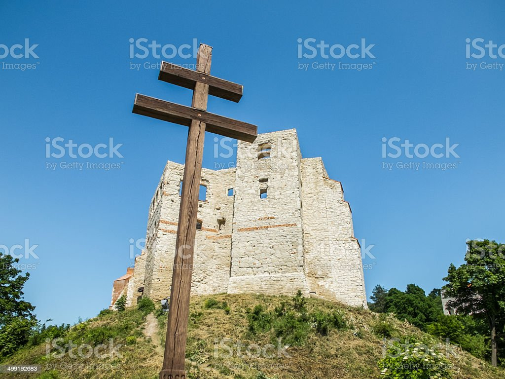 Christian cross and ruins of an old castle stock photo