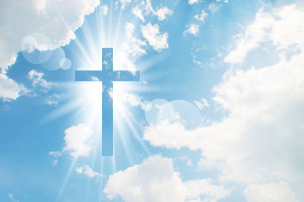 christian cross appears bright in the sky - cross stock photos and pictures