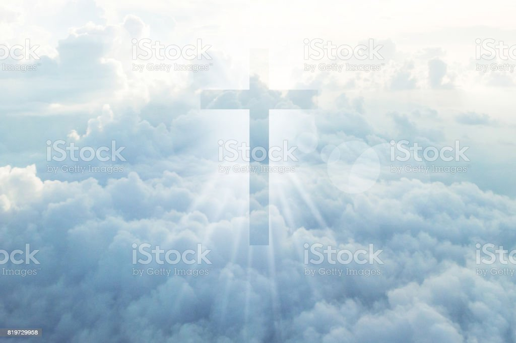 Christian cross appears bright in the sky stock photo