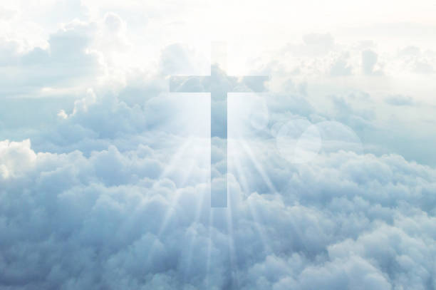christian cross appears bright in the sky - heaven stock photos and pictures