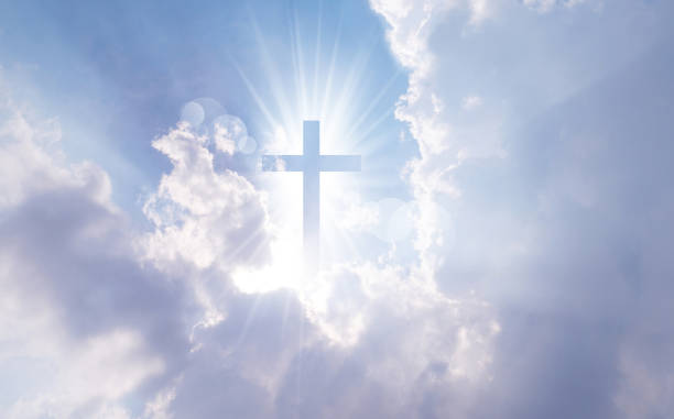 Christian cross appears bright in the sky Christian cross appears bright in the sky background religion stock pictures, royalty-free photos & images