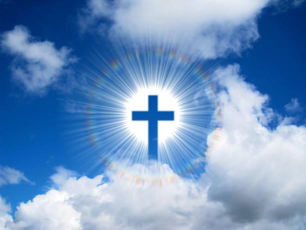 Christian Cross in Sky Background stock photo
