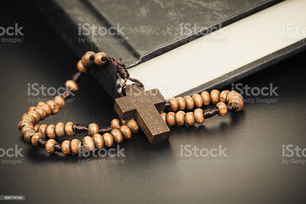 Christian cross necklace on Holy Bible book, Jesus religion concept...