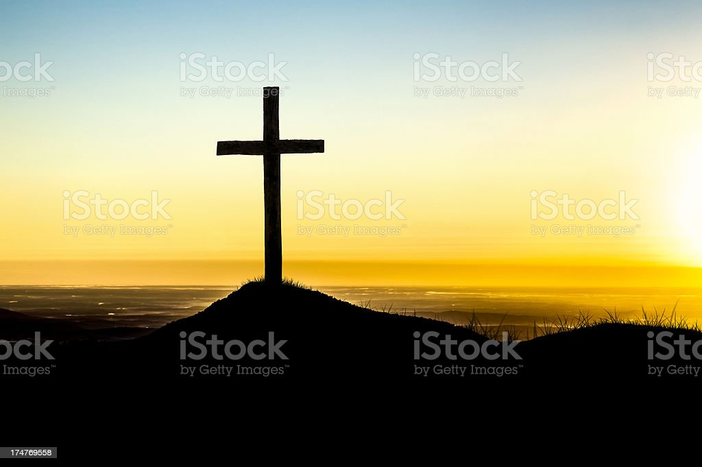 Christian Cross on Hilltop at Sunrise stock photo