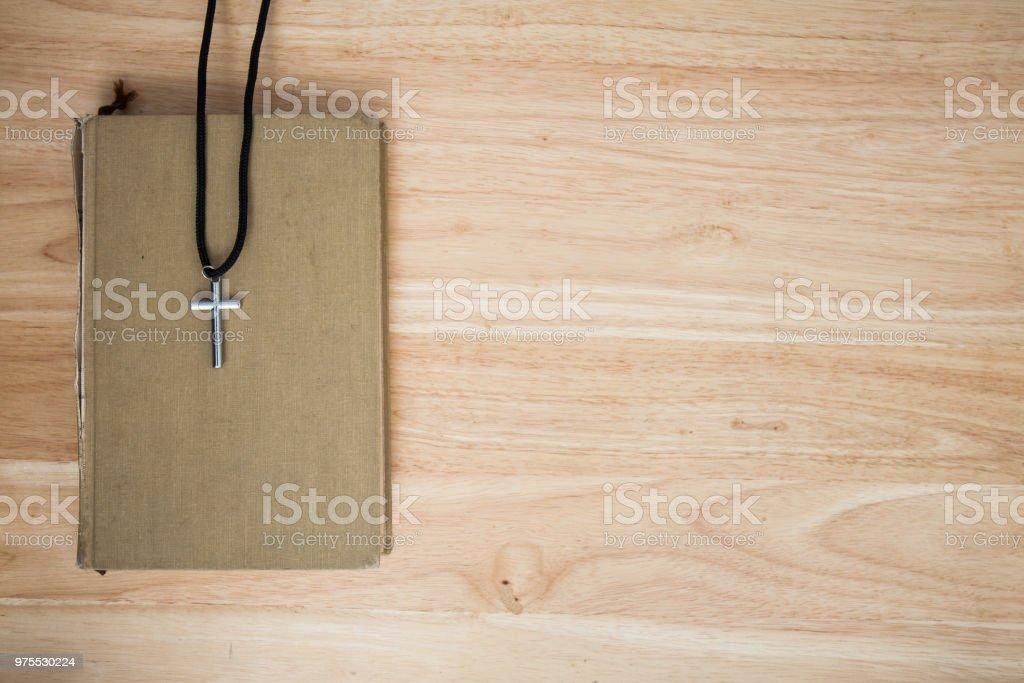 christian cross on wood background stock photo