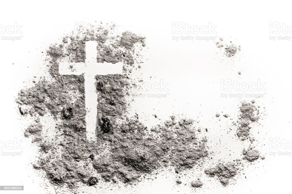 Christian cross or crucifix drawing in ash, dust or sand stock photo