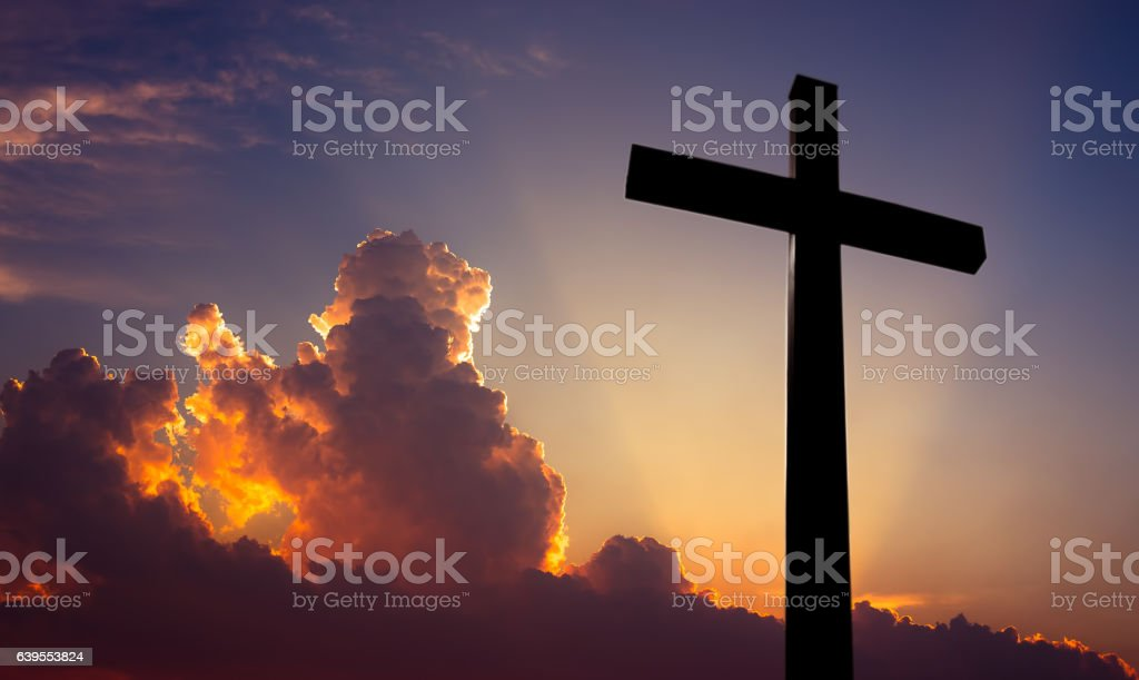 Christian cross over beautiful sunset background stock photo