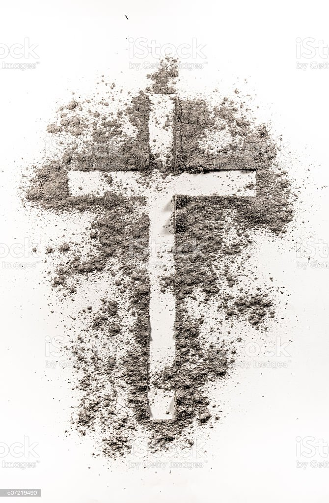 Christian cross symbol made of ash stock photo