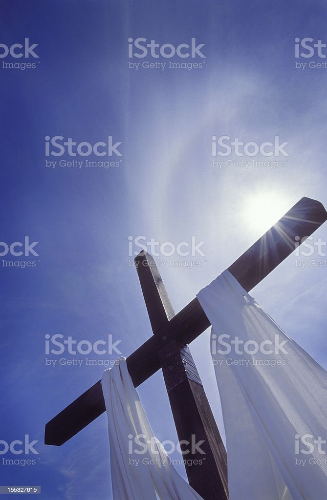Christian cross with halo stock photo