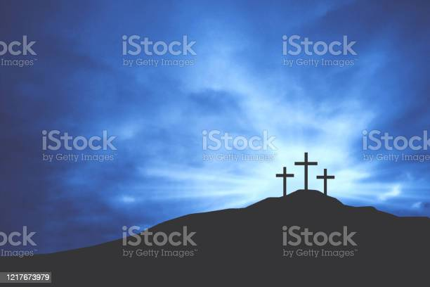 Photo of Christian Easter Crosses on Hill of Calvary with Blue Clouds in Sky and Copy Space