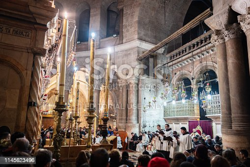 Jerusalem, Israel - April 20th, 2019 : Holy Saturday Christian Easter Mass inside the famous Church of the Holy Sepulchre in front of the Aedicula - Jesus' Empty Tomb. Jerusalem, Israel.