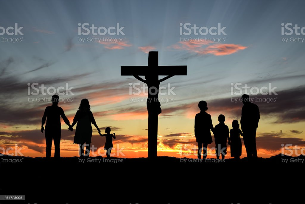 Christian Families Standing Before Cross of Jesus stock photo
