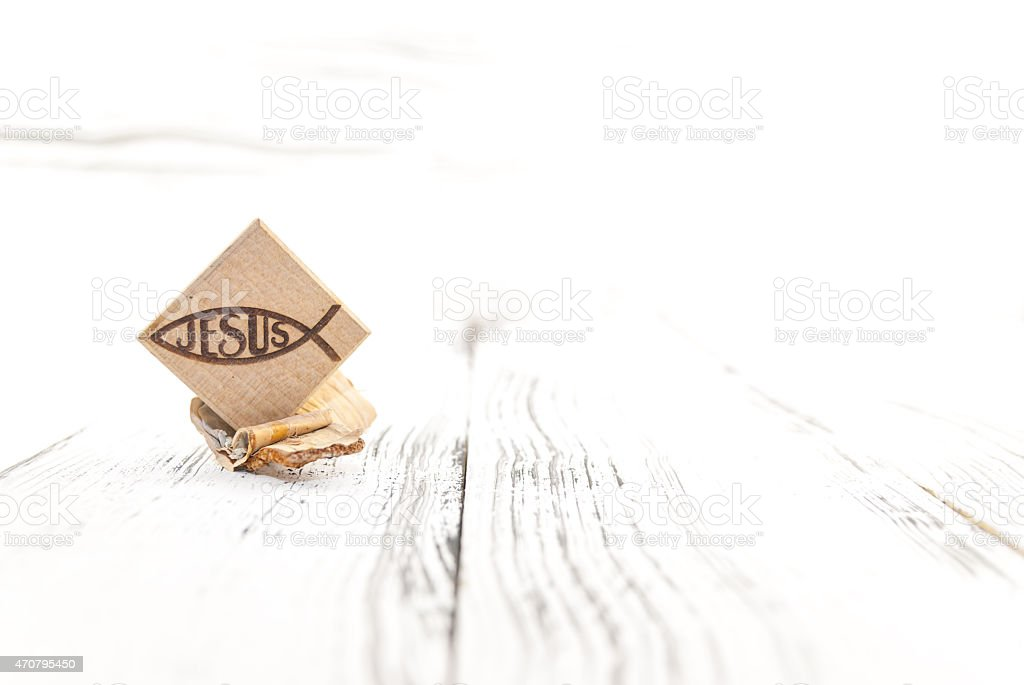 Christian fish symbol carved in wood stock photo