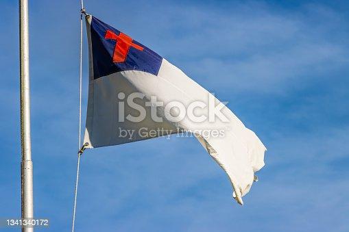 istock Christian flag waving on sunny day 1341340172