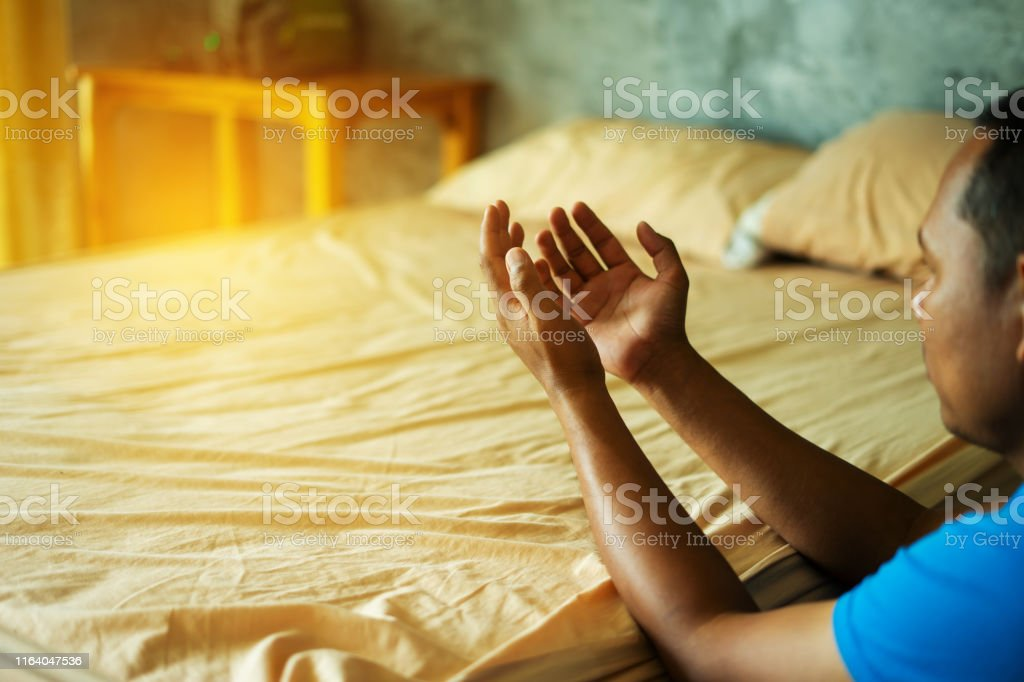 Christian hands raised to worship for bless God with good fortune in...