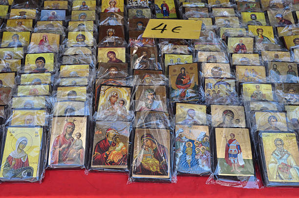 christian icons religious art Athens, Greece - August 15, 2014: Greek orthodox christian icons religious art for sale at street market. religious symbol stock pictures, royalty-free photos & images