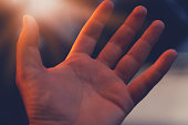 istock Christian man with open hand worship christian. Eucharist Therapy Bless God Helping Repent Catholic Easter Lent Mind Pray. Christian concept background. 1265673969