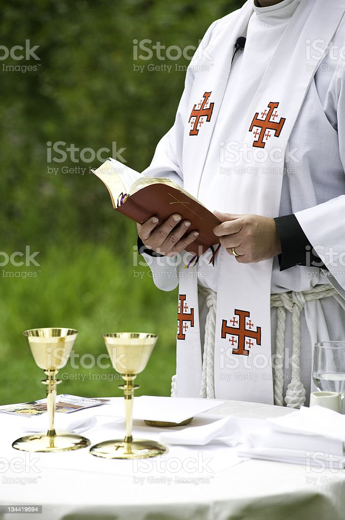 Christian Minister Performing Religious Traditional Acts royalty-free stock photo