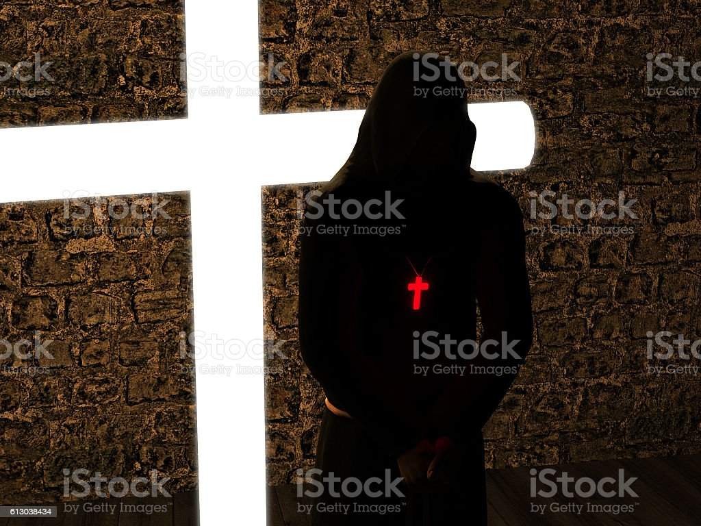 Christian monk with his head bowed, meditating stock photo
