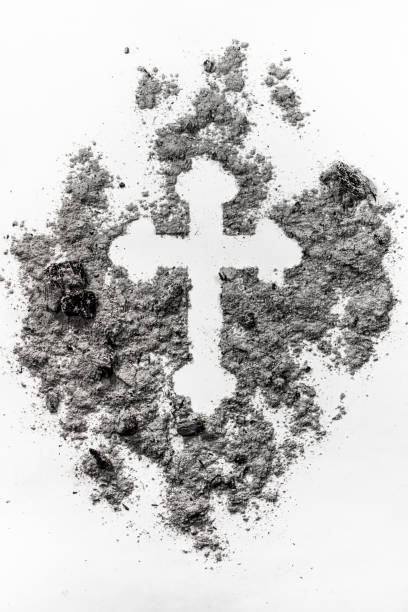 christian orthodox crucifix sign made in grey ash, dust, dirt as a ash religion, ash wednesday symbol - ash cross stock photos and pictures