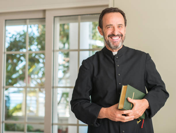 Christian priest man with a happy face standing and smiling with a confident smile showing teeth Christian priest man with a happy face standing and smiling with a confident smile showing teeth clergy stock pictures, royalty-free photos & images