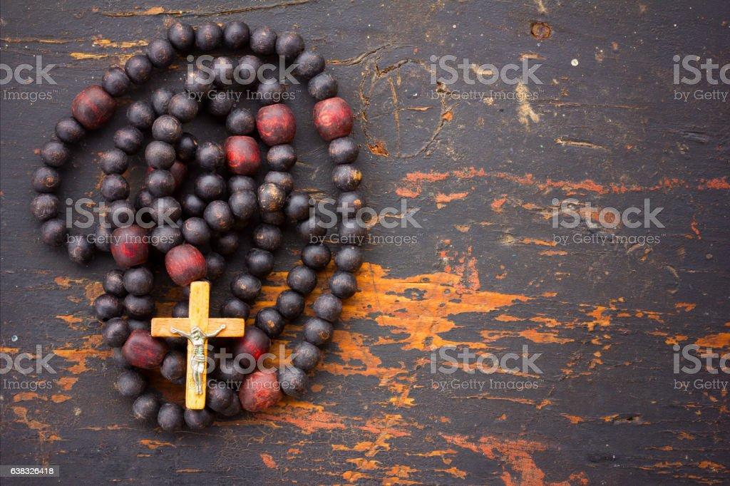 Christian rosary prayer with a cross stock photo