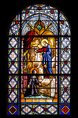 The Crucifixion of Christ shown in an image on a medieval stained glass pane from the St. Mary's Basilica