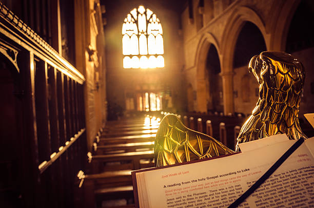 Christian symbolism - Eagle lectern Bible open on an eagle lectern in an English church. pulpit stock pictures, royalty-free photos & images