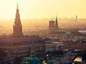 Parliament, court and prime minister office in former royal castle Christianborg. In a distance cathedral and city hall. Closest building - historical stock market.