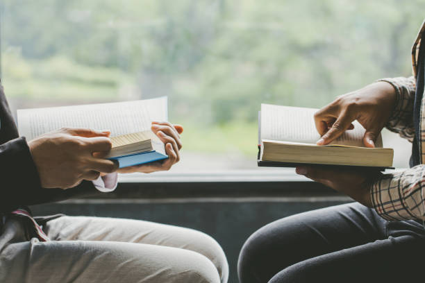 Christians and Bible study concept.Two men studying the bible.