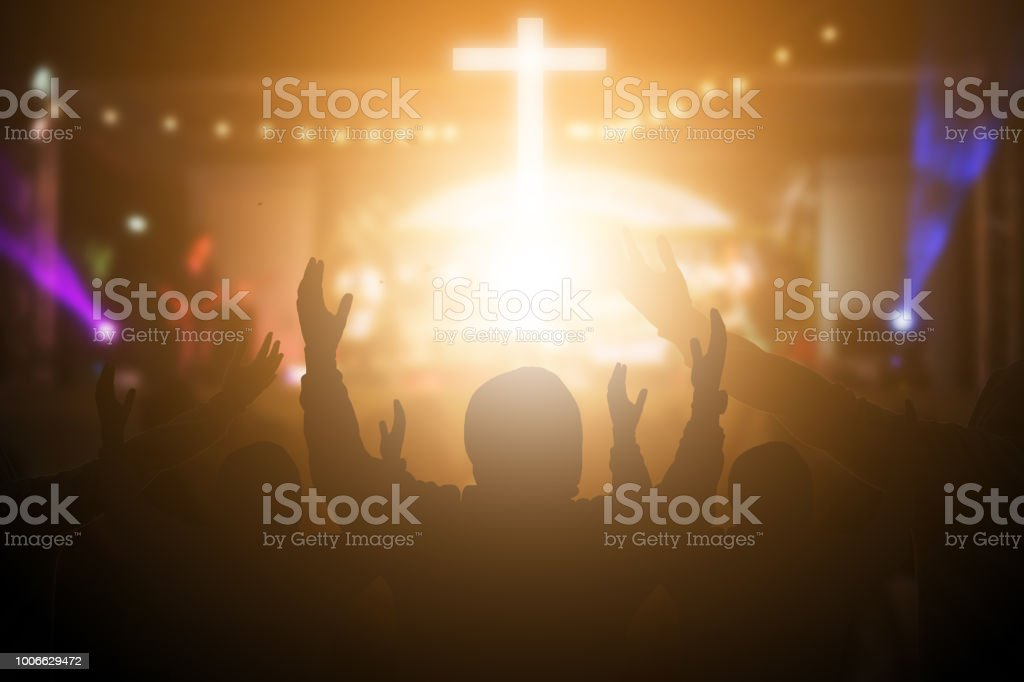 Christians raising their hands in praise and worship at a night music concert. Eucharist Therapy Bless God Helping Repent Catholic Easter Lent Mind Pray. Christian concept background. - Zbiór zdjęć royalty-free (Biblia)
