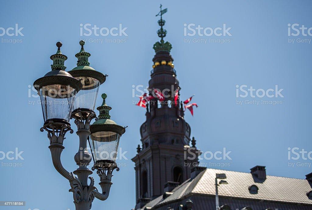 Christiansborg waving the Danish flag on Constitution Day, Copenhagen, Denmark stock photo