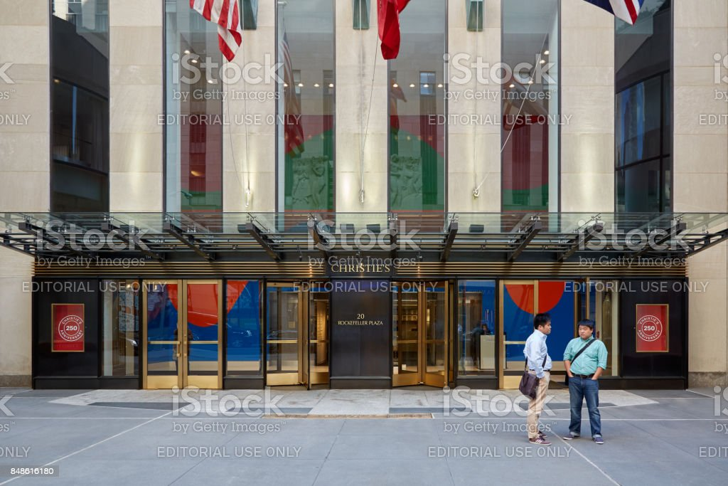 Christie's American branch entrance with people in Rockefeller Center stock photo