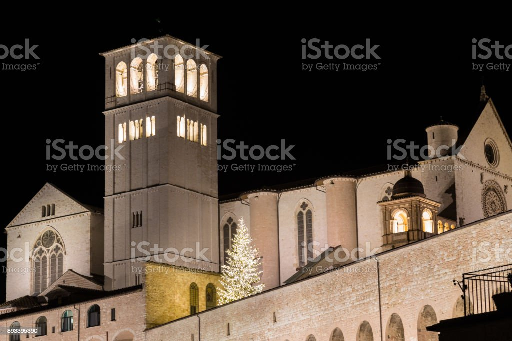 Christmas 2017 in Assisi (Umbria), with a view of San Francesco papal church at night, with big lighted tree stock photo