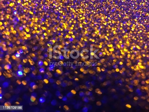 1047386704istockphoto Christmas abstract background -gold blue  bokeh 1139709186