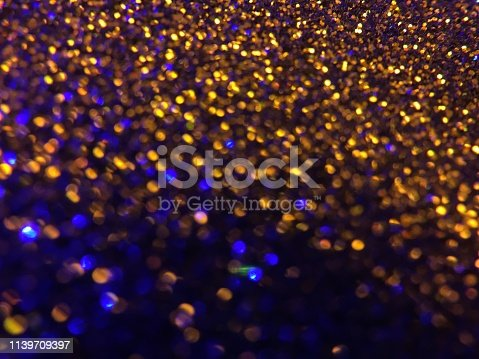 1047386704istockphoto Christmas abstract background -gold blue  bokeh 1139709397