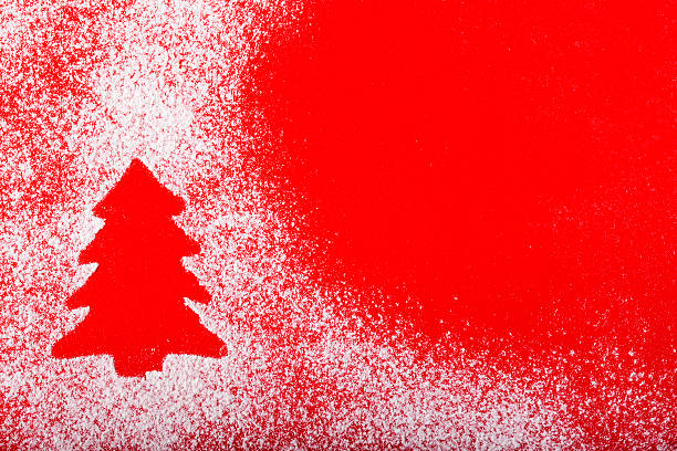 christmas abstract background on red with christmas tree cookie silhouette - filzunterlage stock-fotos und bilder