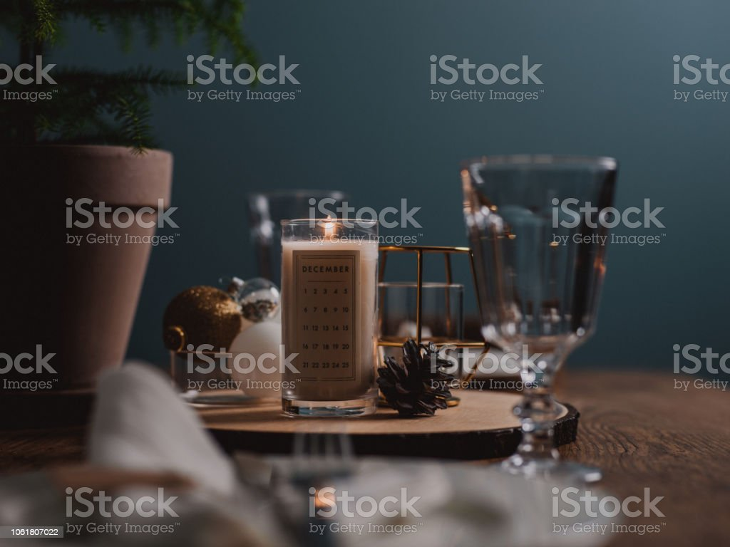 Christmas advent candle light and table setting Place setting on...