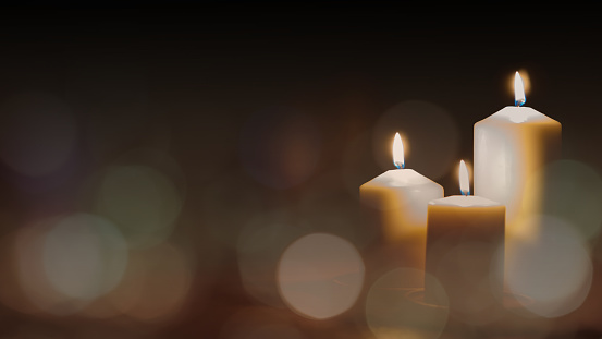 Christmas Advent Candle Light In Church With Blurry Golden Bokeh For Religious Ritual Or Spiritual Zen Meditation Peaceful Mind And Soul Or Funeral Ceremony Stock Photo - Download Image Now