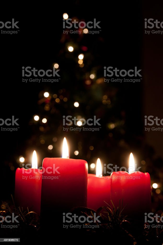 Christmas advent wreath with red burning candles. Lights on x-mas...