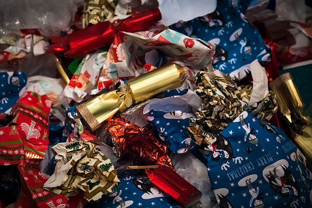 christmas aftermath - wrapping paper stock photos and pictures