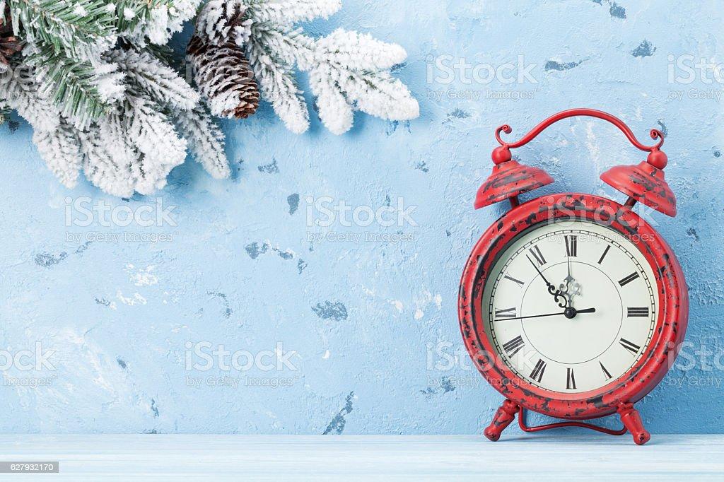Christmas alarm clock and snow fir tree stock photo
