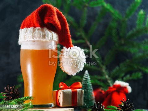 Christmas ale glass in Santa's festive hat. Christmas party